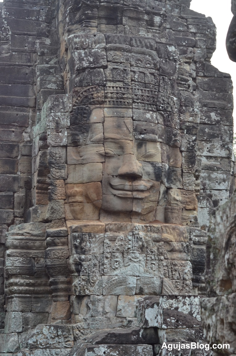 Large face on the walls at Angkor Wat.