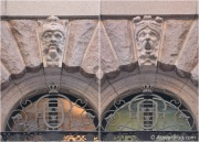 Stone faces on the facade of the Parliament House.